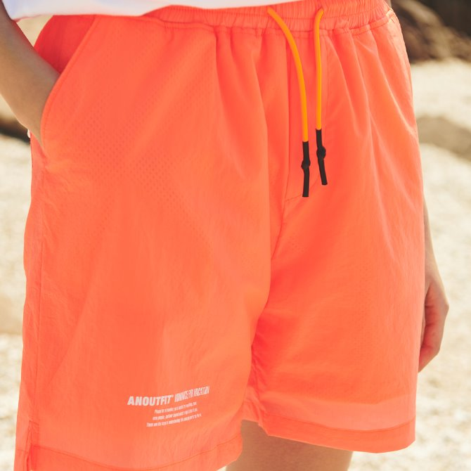 UNISEX MONO STRING SHORT PANTS NEON ORANGE